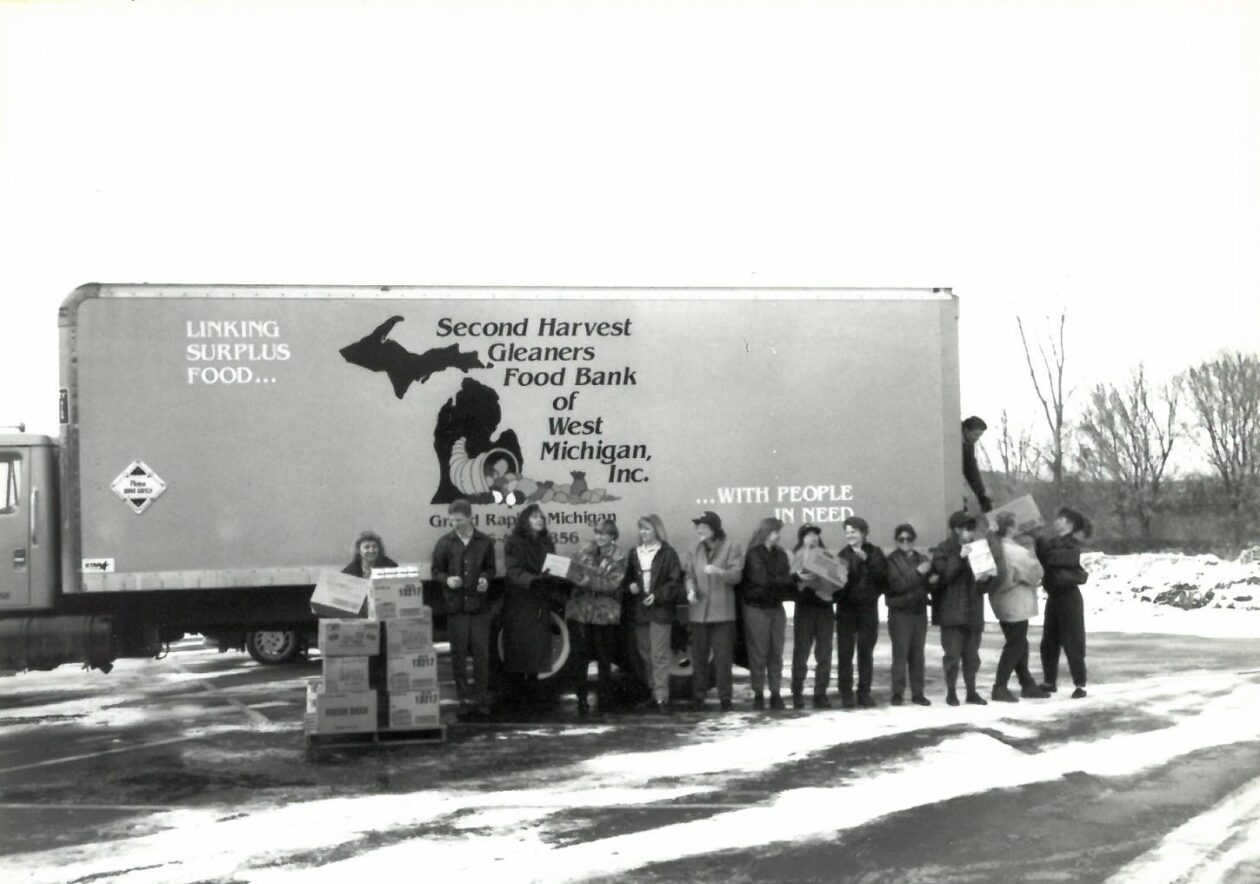 truck with assembly line of volunteers in front
