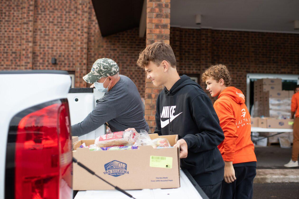 Mobile Pantry volunteers load a truckbed