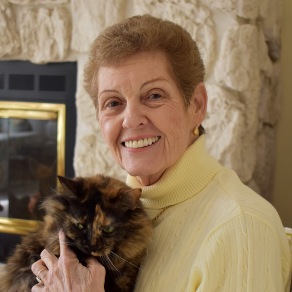 Karen holding cat, smiling