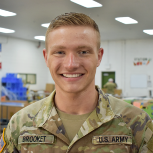 SPC Brooket poses in the food bank's reclamation area