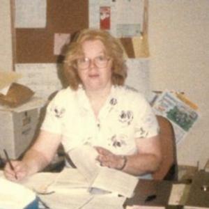 Gretchen sits at her desk