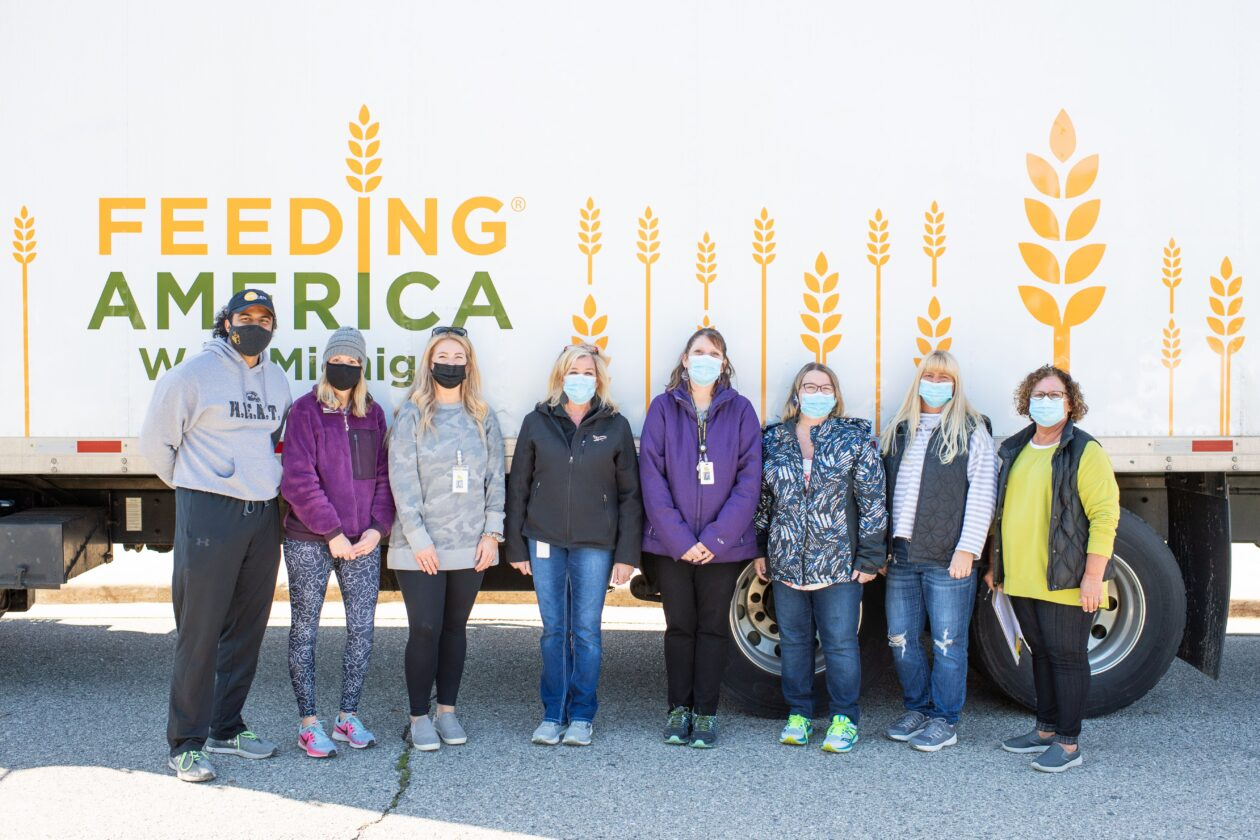 Hamilton Schools volunteer team poses with a truck