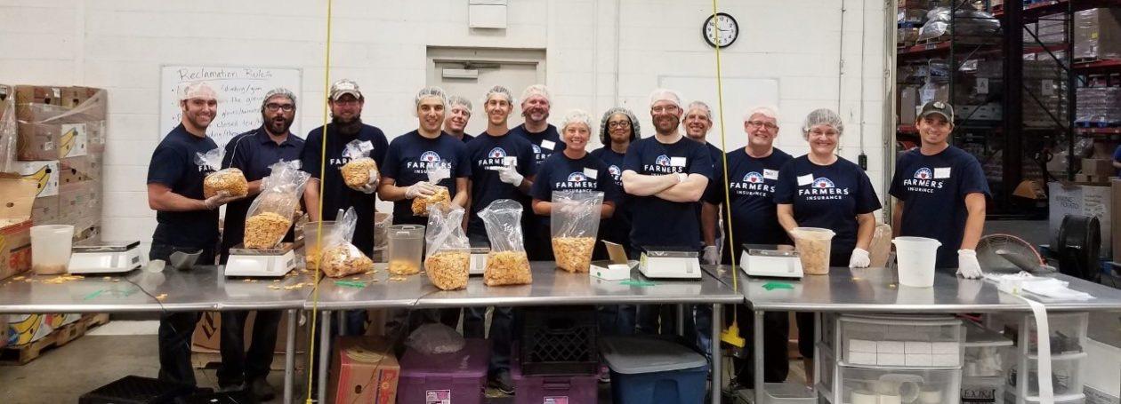 Farmers Insurance employees volunteering in reclamation